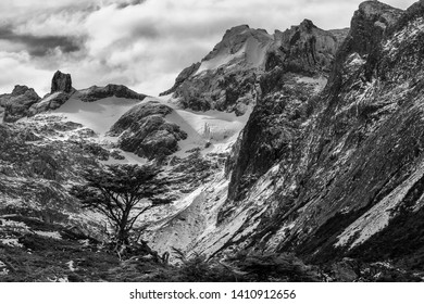 Black and white photography with strong contrasts, in the snowy mountains of Patagonia, Argentina