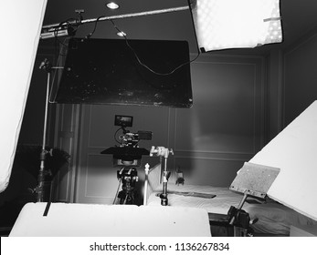 Black and white photography in a studio.