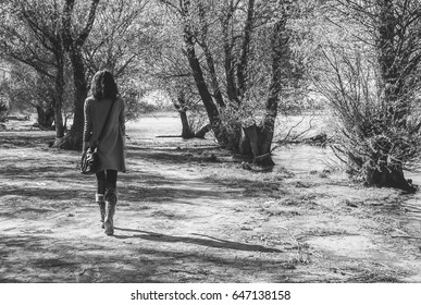 Black And White Photography Of Young Woman Walking Alone In The Nature