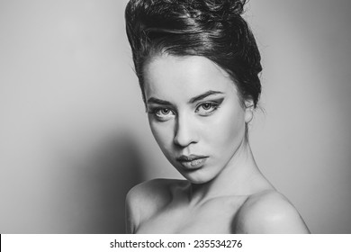 Black and white photos of a beautiful girl with beautiful hair, beautiful eyes, lips, interesting hairstyle