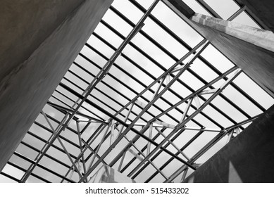 Black and white photo,Structure of steel roof frame for building construction.