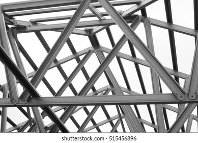 structure of steel roof frame for building construction on sky Metal Beam Texture black and white photo structure of steel roof frame for building construction