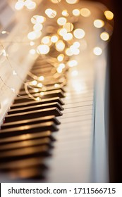 Black and white piano keys, bokeh on the background. Music concept