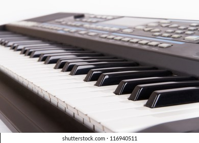 Black and white piano keys with depth of field on white.