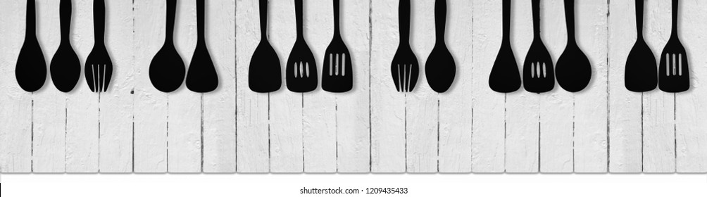 Black and white piano keys made from white hard wood and black utensils. Music and Restaurant Concept.