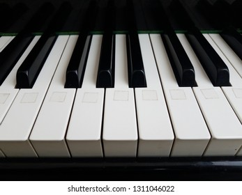 black and white piano keys with white sticker