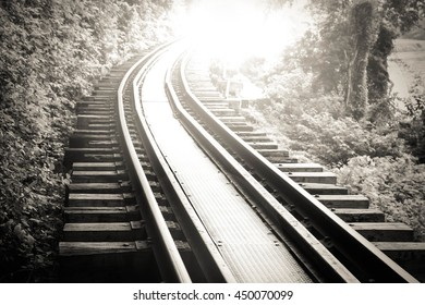 black and white picture of beautiful railroad at sunset