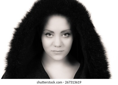black and white picture of beautiful woman looking straight into the camera with a serious look