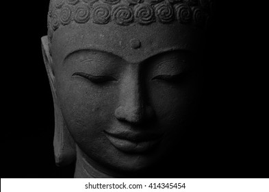 Black and white picture of Buddha statue. Buddha's face