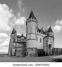 A black and white picture of the Castle of Saumur taken from near its entrance.