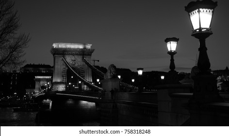 Black and white picture of Chain Bridge spans Danube river in Budapest, Hungary
