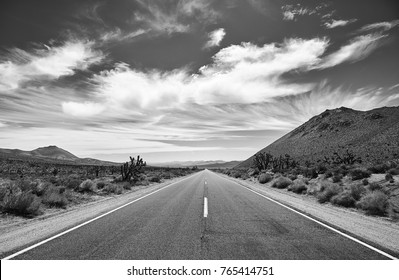 Black and white picture of the Death Valley desert road, travel concept, USA.