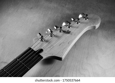 Black and white picture of electric guitar head