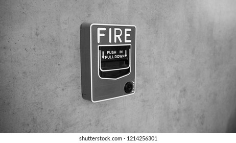 BLack and white picture of Emergency of Fire alarm system notifier or alert or bell warning equipment use when on fire (Manual Pull Station).