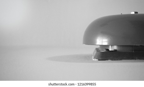 BLack and white picture of Emergency Fire alarm or alert or bell warning equipment red color on white background wall in the building for safty.
