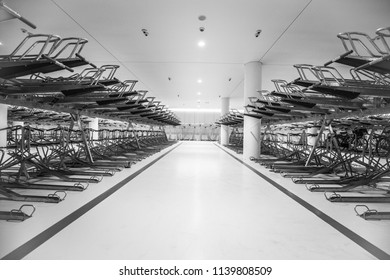 Black and white picture of an empty bicycle garage in Amsterdam, Netherlands