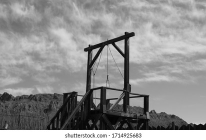 Black and white picture of a hangman's  gallows with a noose.