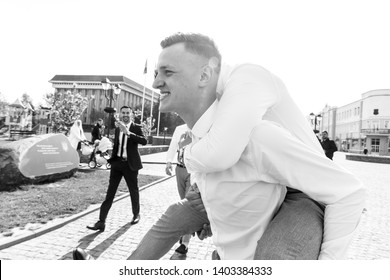 black and white picture of Groom with groomsmen walking after wedding ceremony. Handshakes