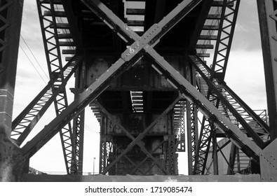 (Black & White) Picture of metal construction under random bridge near university city