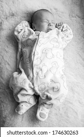 black and white picture of a newborn baby
