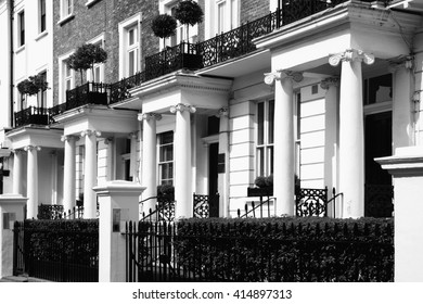 Black and white picture of old fashioned typical Regency Georgian terraced town houses building architecture in fashionable Notting Hill, Kensington, London, England, UK