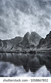 Black and white picture of Retezat mountains on a stormy day