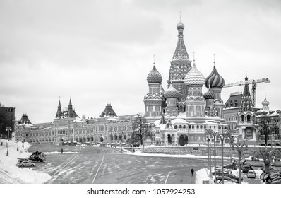 A black and white picture of Saint Basil's Cathedral, the Red Square and a shopping center.
