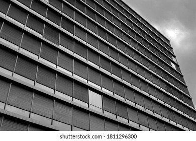 Black and white picture showing a modern facade plenty of glass rectangular windows in Bergen
