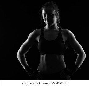 A black and white picture of a woman posing with fist wraps
