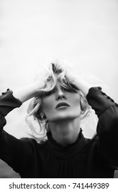 Black and white picture of woman shaking her hair