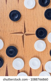black and white pieces on backgammon board