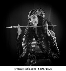 black and white portrait of a actress woman in a pirate costume on a black background