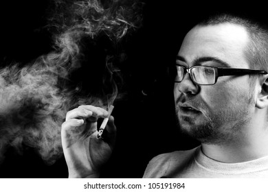 Black and white portrait of bearded man smoking cigarette