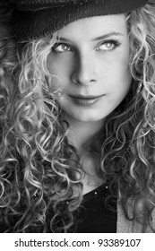 black and white portrait of beautiful blond girl with curly hair