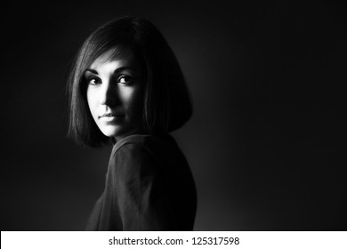 Black and white portrait of beautiful brunette woman with bob hairstyle