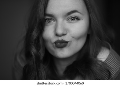black and white portrait of a beautiful and cheerful girl, expressive look, sincerity, beautiful smile