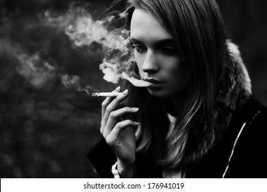 Black and white portrait of a beautiful girl smoking