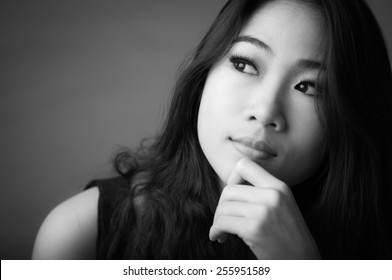 Black and white portrait of beautiful happy woman