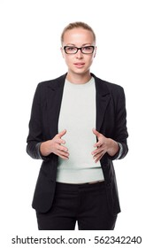 Black and white portrait of beautiful smart young businesswoman in business attire wearing black eyeglasses, standing with open body arm gesture against white background.