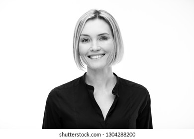 Black and white portrait of a beautiful smiling woman on a white background