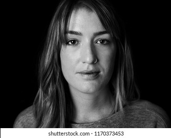 Black and white portrait of beautiful twenty something woman.