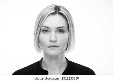 Black and white portrait of a beautiful woman on a white background