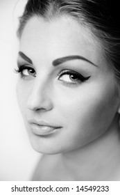 Black and white portrait of beautiful woman with trendy makeup
