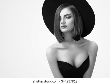 black and white portrait of a beautiful woman in a hat