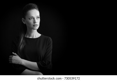 black and white portrait of a beautiful woman with copy space