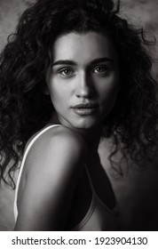 Black and White Portrait of Beautiful young curly woman.