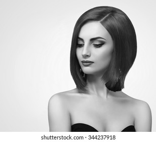 black and white portrait of a beautiful young woman with a bob hairstyle on a white background