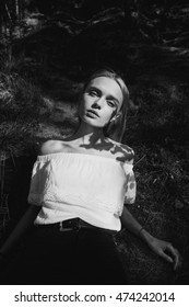 black and white portrait of a beautiful young blonde girl in the woods