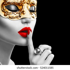 Black and white portrait of Beauty model woman wearing venetian masquerade carnival mask at party isolated on black background. Christmas and New Year celebration. Glamour lady with perfect make up