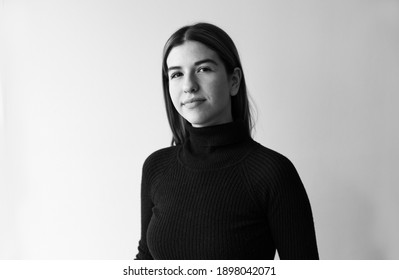 Black And White Portrait Of A Beauty. She is wearing a black sweater